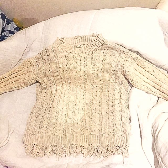 Knitted ripped jumper