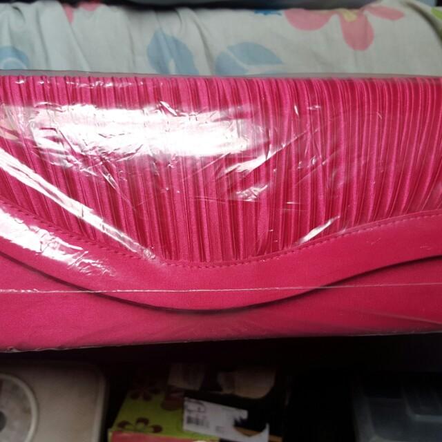 Pink clutch bag