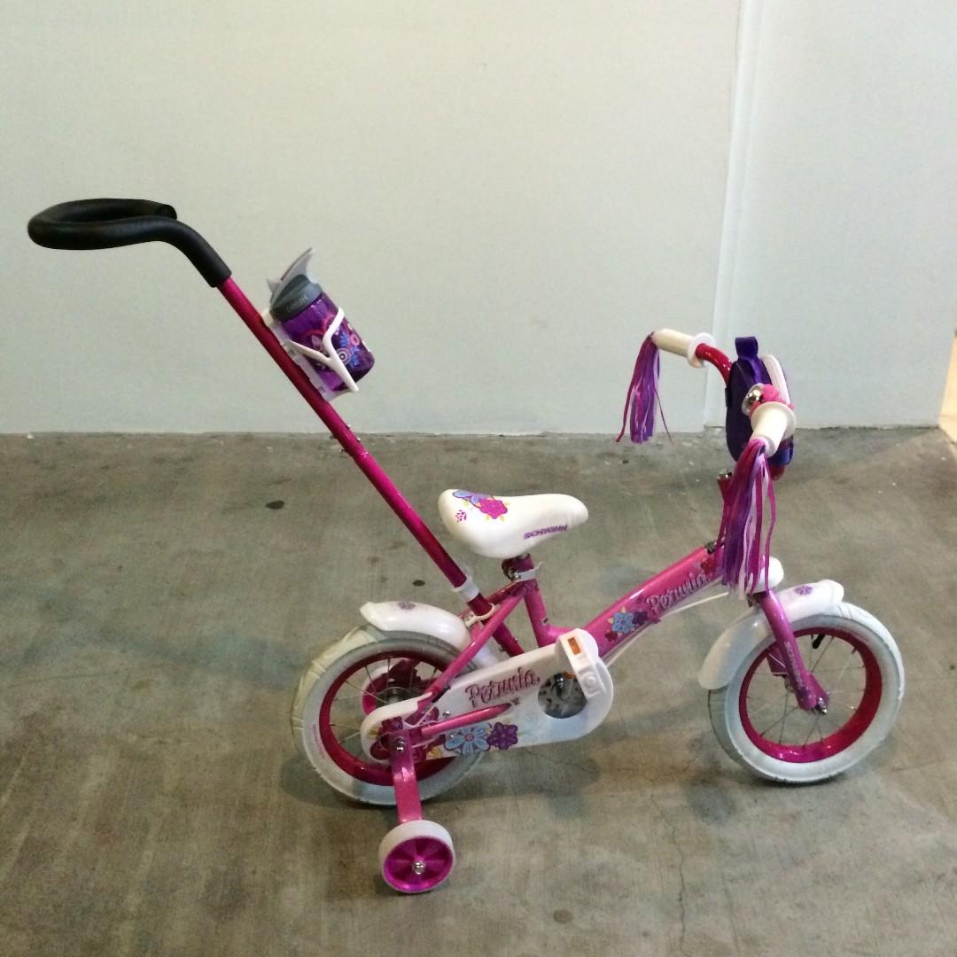 ce02c70630b Schwinn Girls' Petunia 12-inch Steerable Bike,Pink/White, Babies & Kids,  Toys & Walkers on Carousell