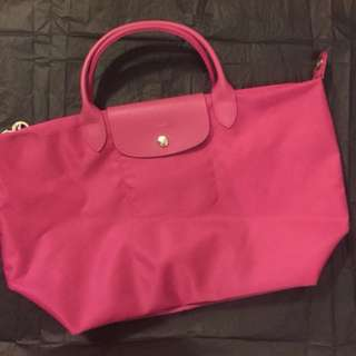 Pink Long Champ handbag two ways