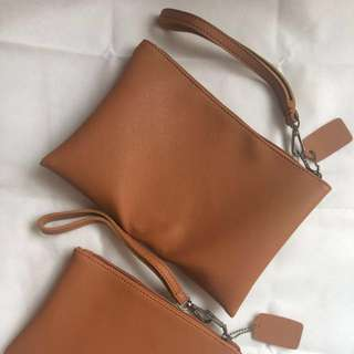 Set of two camel brown clutch bag