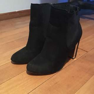 Black boots with gold heels