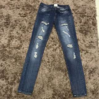 Mng ripped jeans