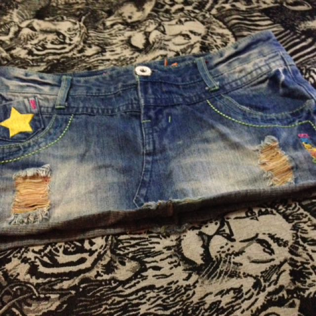 Denim mini skirt with cool patches