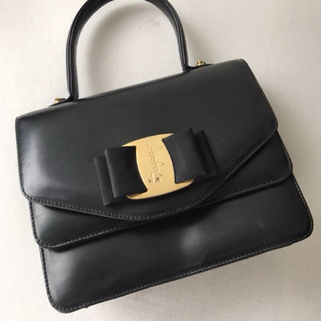 Firm on the price.  excellent condition authentic Ferragamo satchel - no inclusions