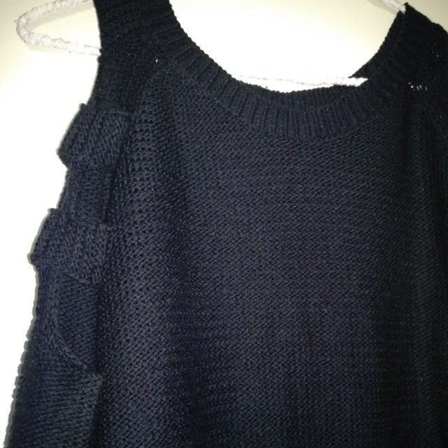 Sweater with arm cut outs
