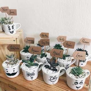 Hand-drawn faces espresso cups succulents