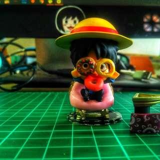 Monkey D. Luffy. Eating doughnuts.