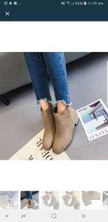 Woman mid heel ankle zipper platform shoe