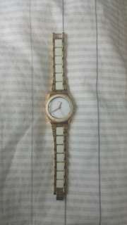Gold and White Swatch Watch