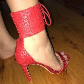 Red snake patterned heels