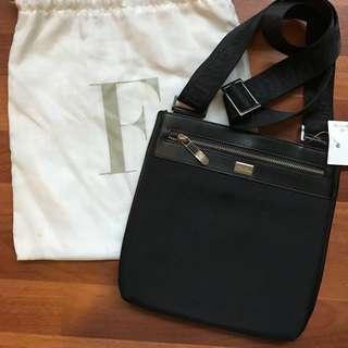 Like new! FERRE sling bag