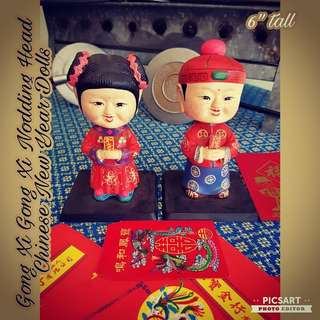 """Vintage Chinese New Year well-wishing Porcelain Boy and Girl with spring under the heads so that they can move. Good Condition. 6.5""""H. Both for $38 Offer. Sms 96337309 for Fast Deal."""