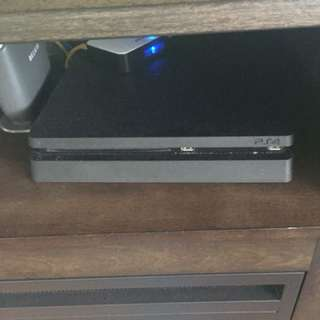 PlayStation 4 with 1 controller and 2 games