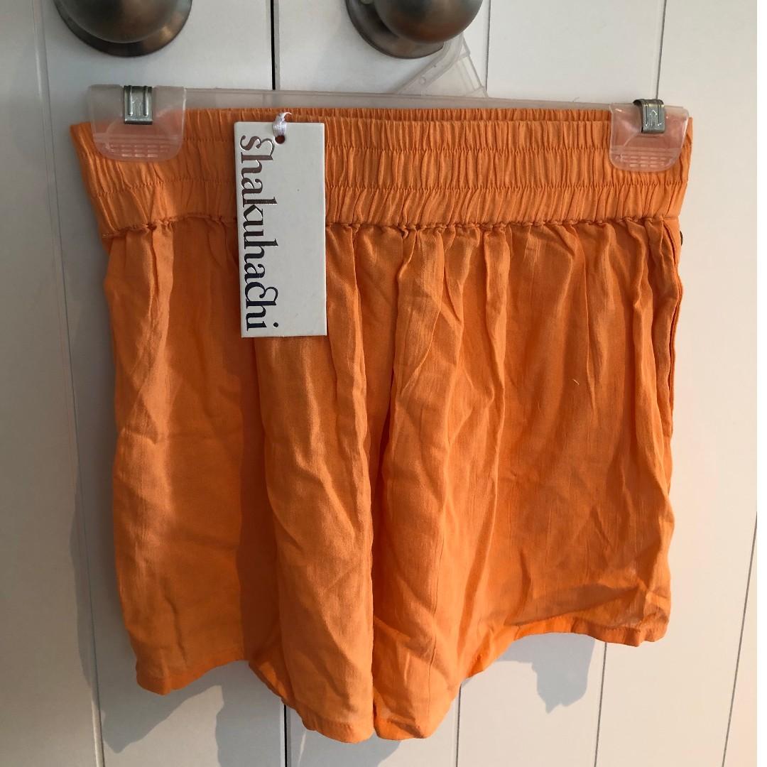 SHAKUHACHI orange shorts