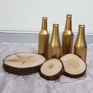 Wood logs and gold bottles
