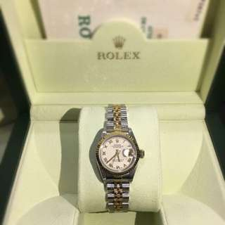 Authentic Rolex Datejust. Two tone 18k gold and stainless steel, ladies size, pyramid dial.