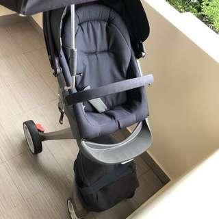 Stokke Xplory + iZi Go car seat set