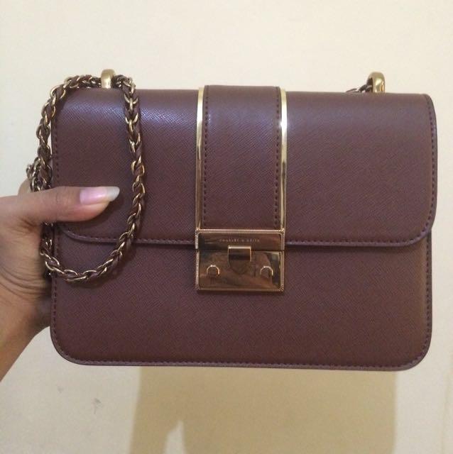 brown sling bag by Charles & keith