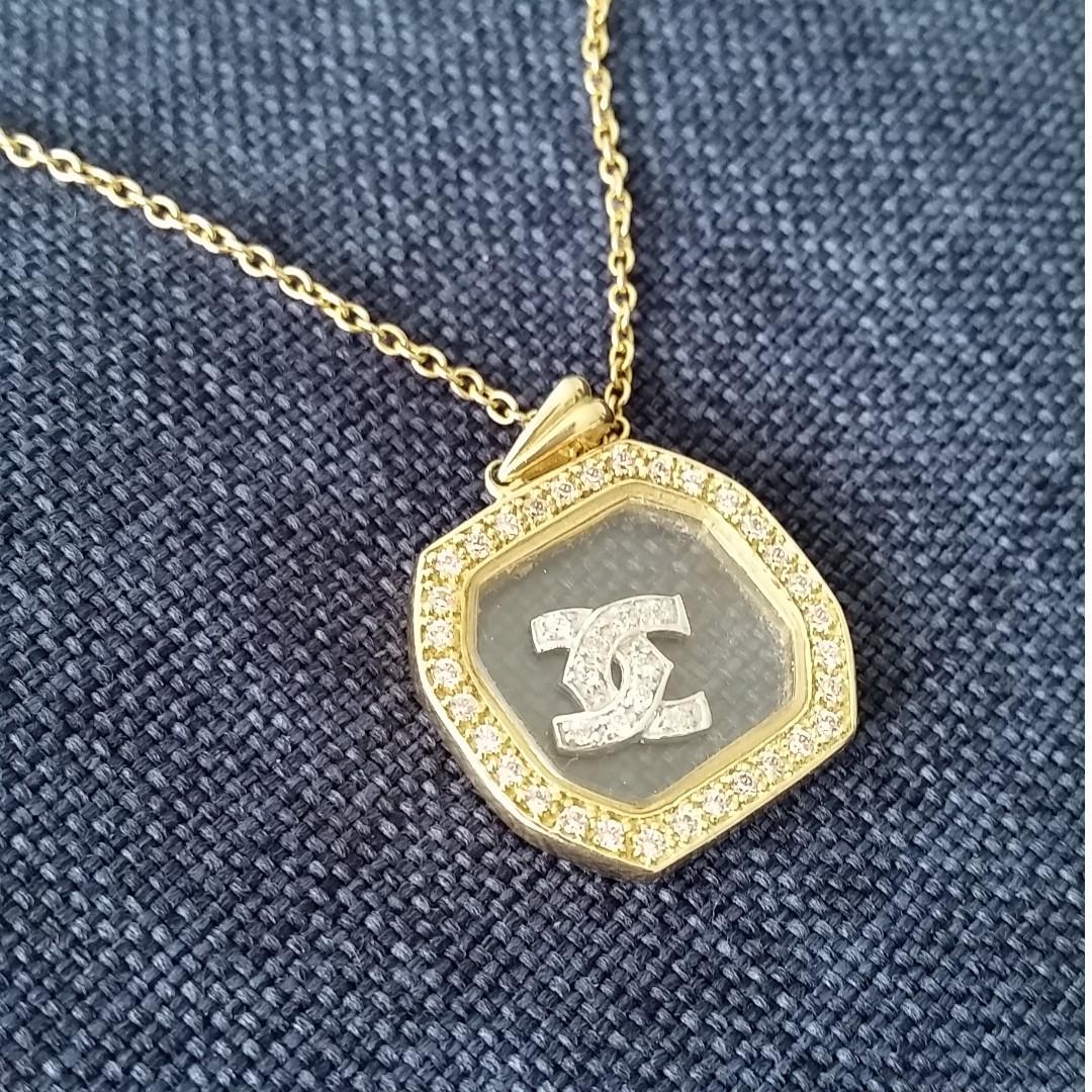 Stunning floating glass encased gold chanel logo pendant luxury photo photo aloadofball Choice Image