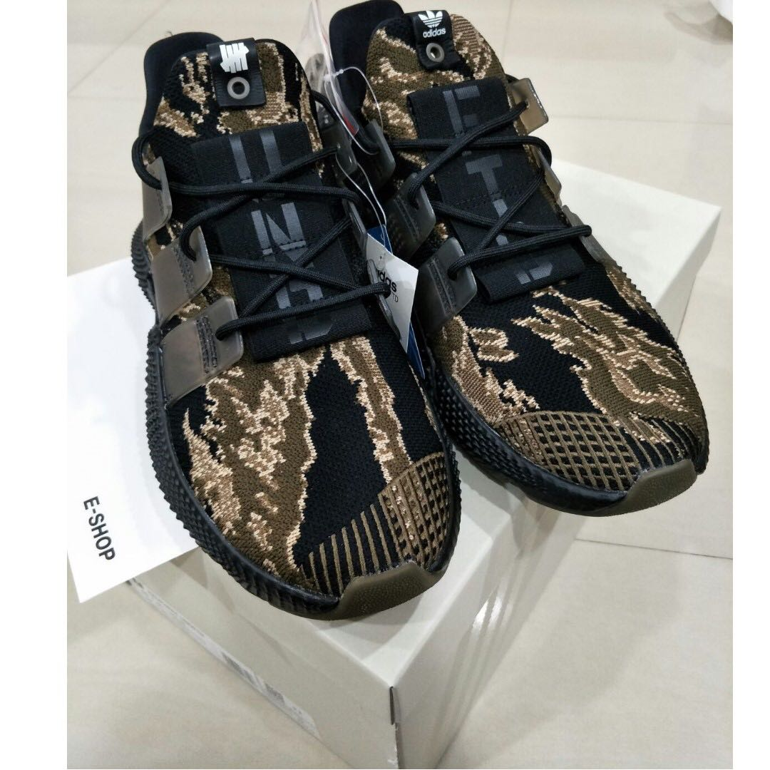 check out dd701 581ef UNDEFEATED X ADIDAS PROPHERE