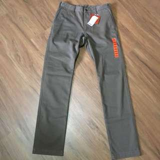 Uniqlo wind proof slim fit chino flat front pants