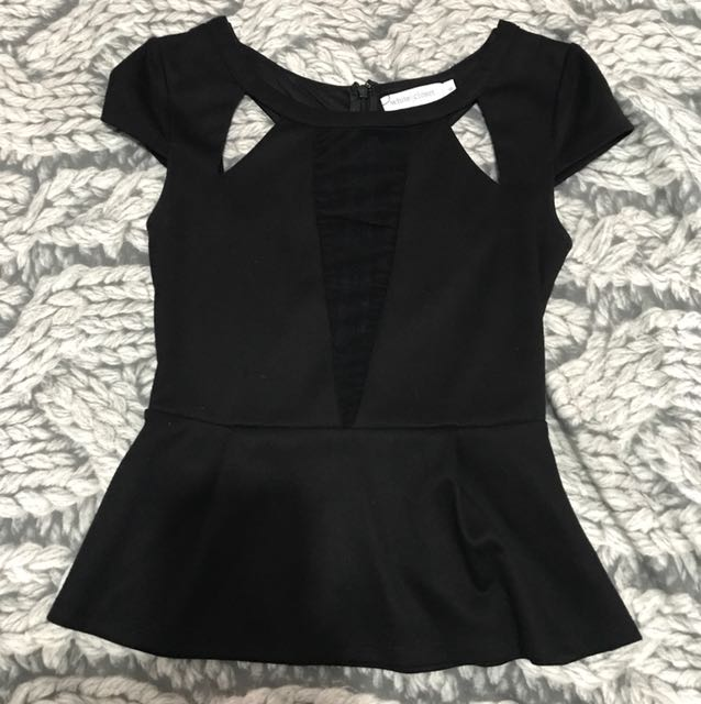 Black peplum top with mesh cleavage