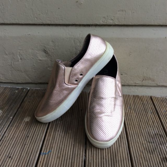 Rose gold and white plimsoles