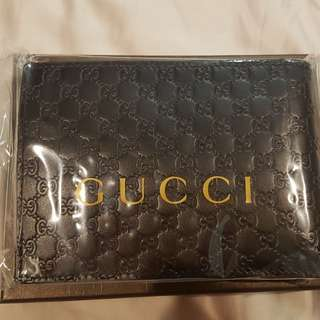 Gucci embossed wallet for the men (Black)