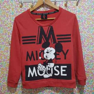 Folded & hung mickey mouse pull over