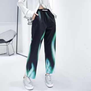Green high-waisted flame pants