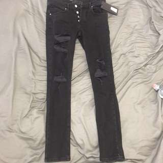 Men's black ripped skinny jeans