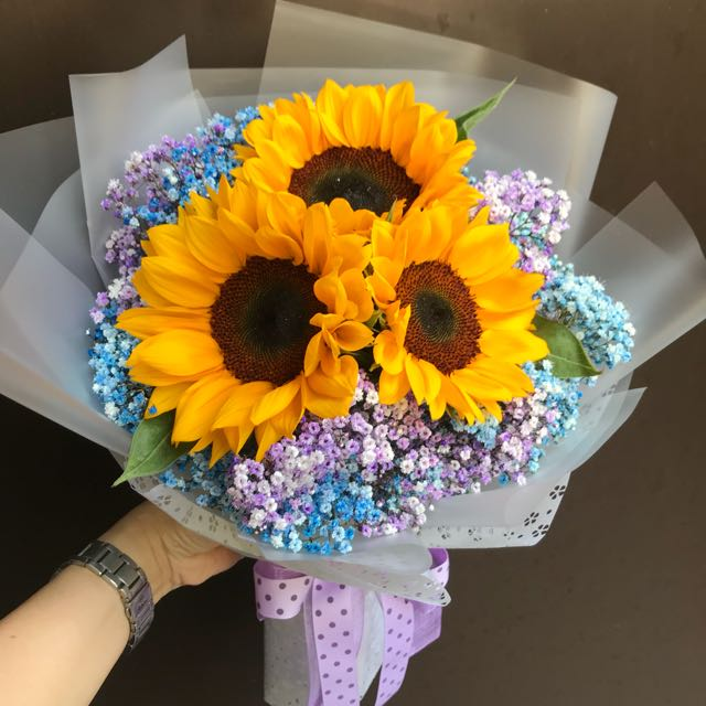 3 sunflowers and colored baby breath bouquet