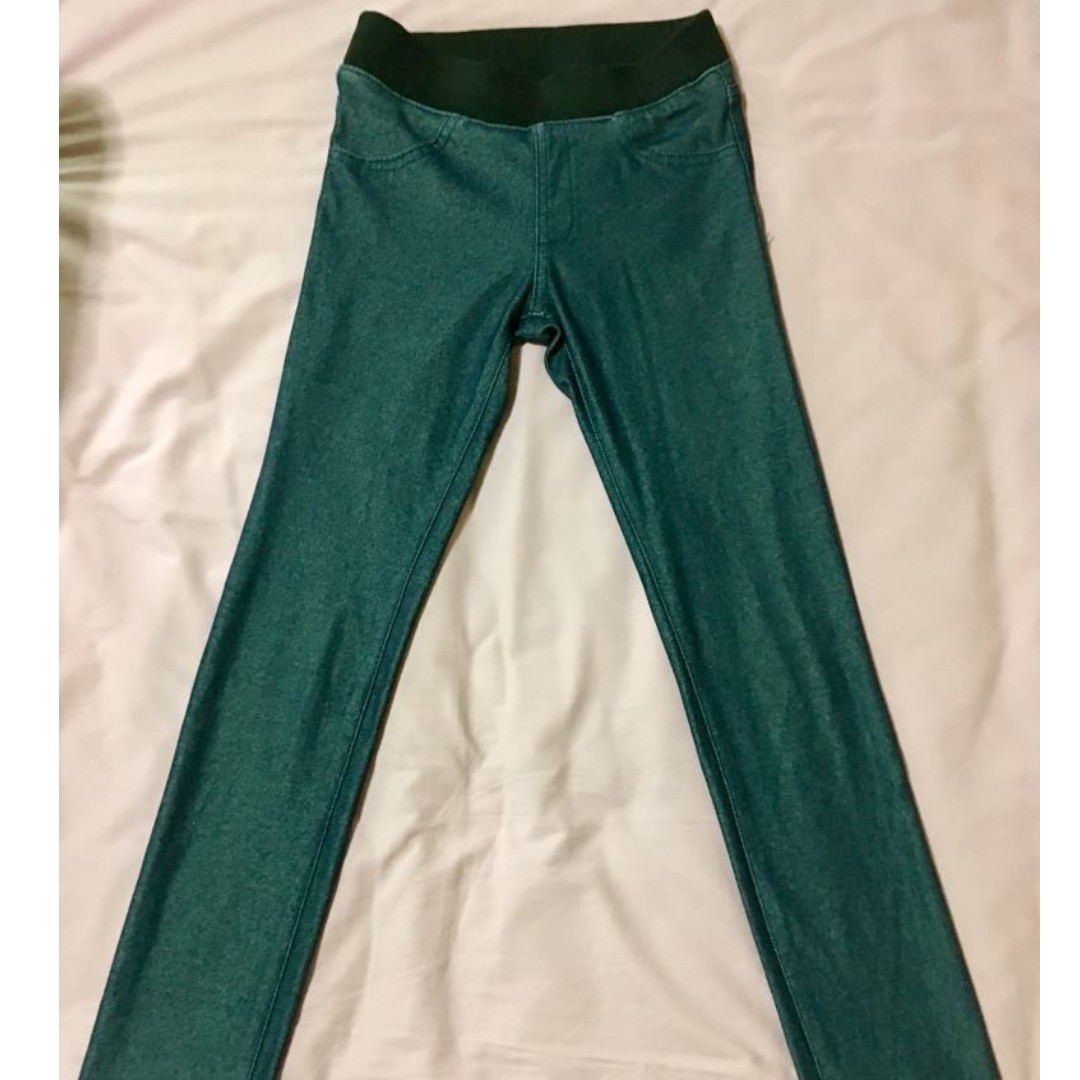 Blue jeggings with black stretch waist band