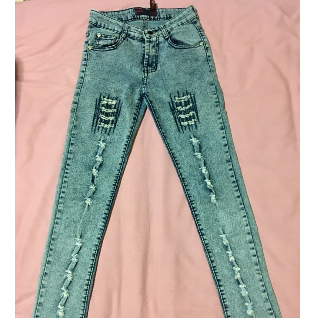 blue tattered denim jeans