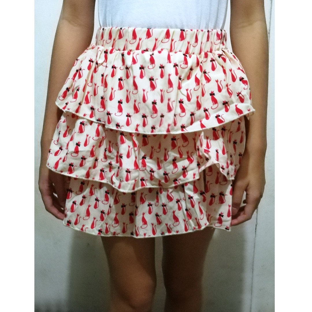 Cream colored with cat print pattern ruffled skirt