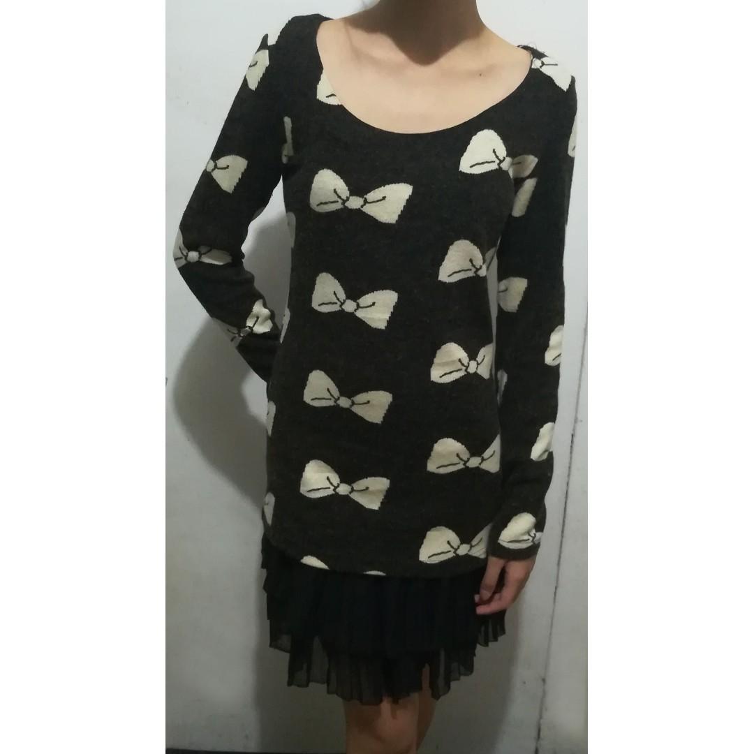 Dark brown with cream colored ribbon pattern & black ruffled hemline, long sleeved dress