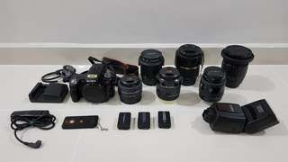 Sony A33 + 6 lens + flash + batteries + wire/wireless remote + bag.