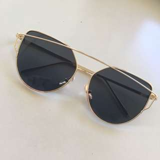 Gold framed X black lenses // Sunglasses