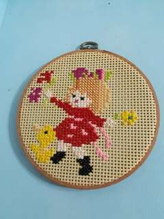 small vintage cross stitch of girl w dog