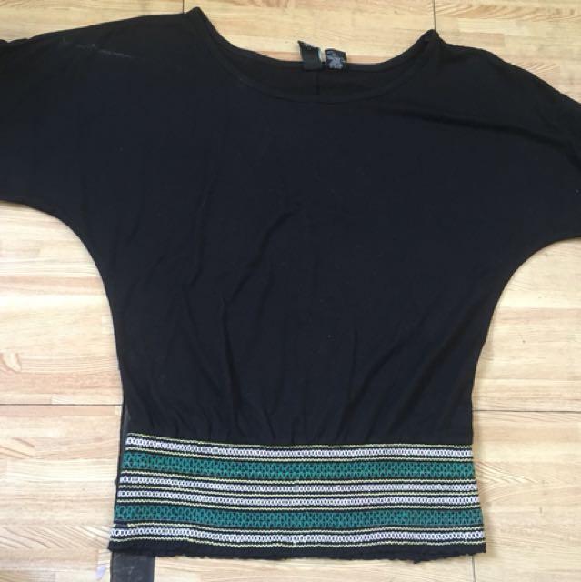 Black blouse with garterized waist detail