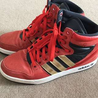 Red Adidas gold strip shoes