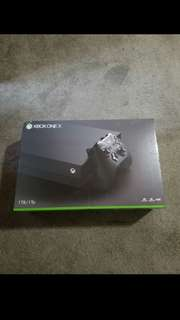 Xbox One X (never opened)