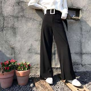 Black trousers with belt