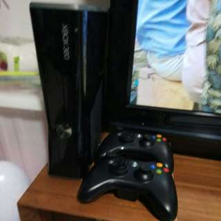 Xbox 360 with two controllers, kinect & 17 preloaded games