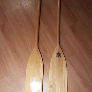 Two wooden canoe paddles