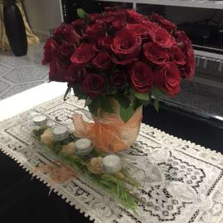 Gold vase filled with Red Roses