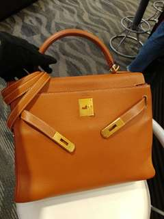 Hermes kelly 32 gold clemence