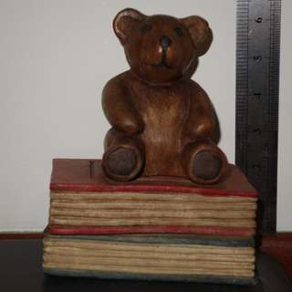6 inch tall Wooden Teddy seated on books collector.