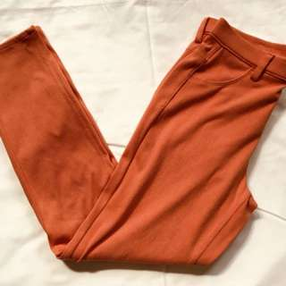 Uniqlo Orange Stretch Pants with button detail